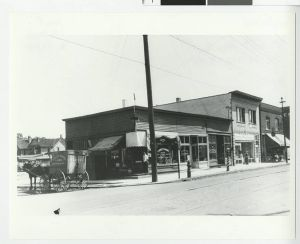 Storefront_and_wagon_at_6th_Avenue_North_and_8th_Avenue_North,_Minneapolis